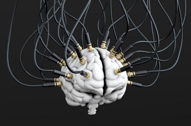 photo credit: 3D illustration of cables connected to brain, mind control concept. vasabii/Shutterstock
